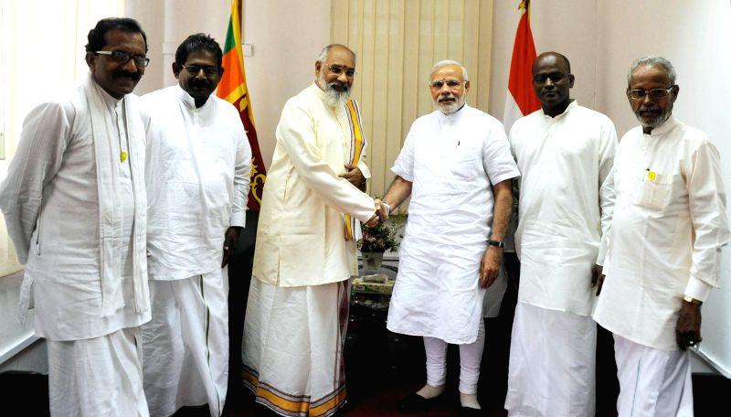 Northern Province, Sri Lanka Chief Minister C V Vigneswaran meets the Prime Minister Narendra Modi, at Jaffna Public Library, in Jaffna, Sri Lanka on 14 March 2015. - Narendra Modi