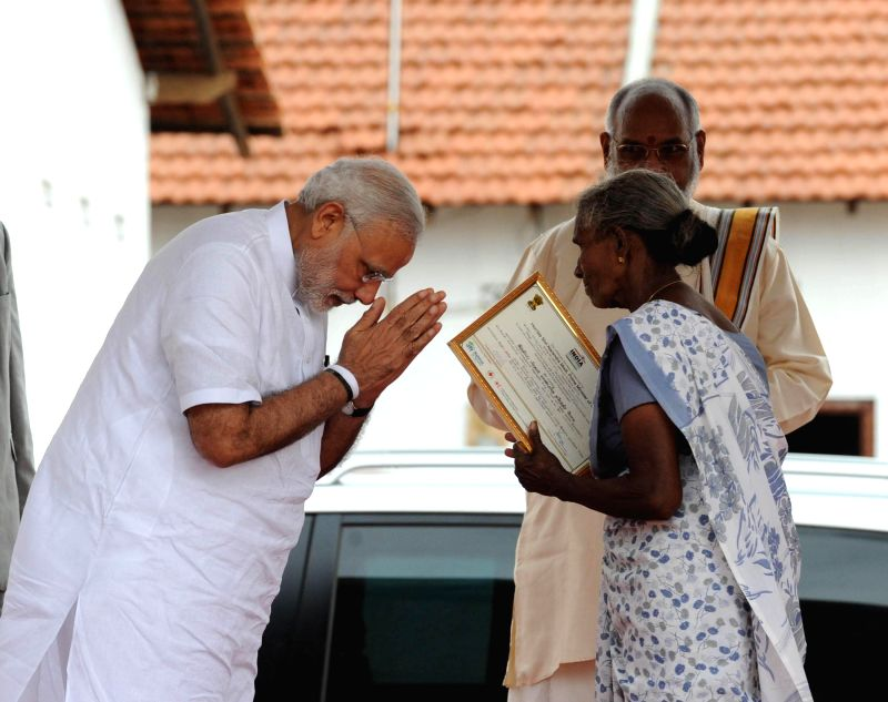 Prime Minister Narendra Modi at the handing over of homes, at Ilavalai North-West Housing Project site, in Jaffna, Sri Lanka on 14 March 2015. - Narendra Modi