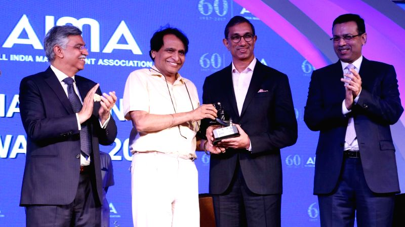 Jagran Prakashan Ltd. Editor in Chief and CEO Sanjay Gupta receives Lifetime Contribution to Media award from Union Railway Minister Suresh Prabhu at the AIMA Awards ceremony in New Delhi, ... - Suresh Prabhu and Sanjay Gupta