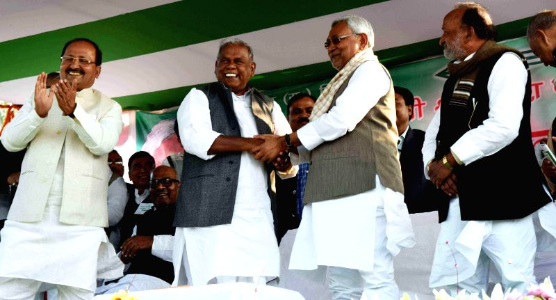 Bihar Chief Minister Jitan Ram Majhi  and JD(U) leader Nitish Kumar during a party programme in Jahanabad of Bihar on Nov 25, 2014.