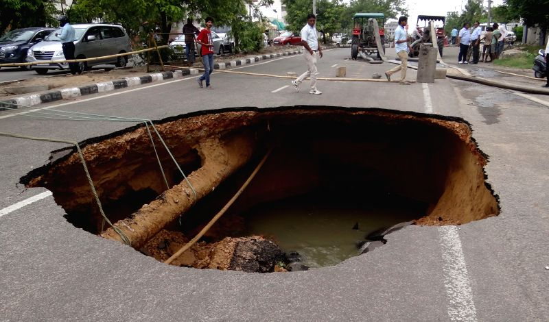 A Jaipur road caves-in after rains on June 15, 2015.