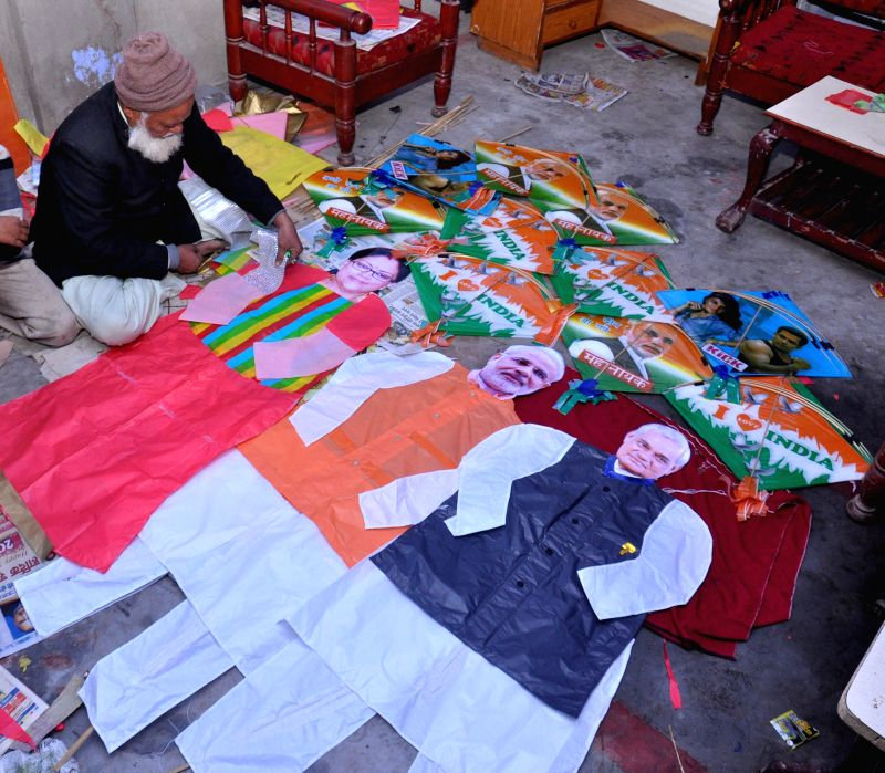 A kitemaker creates a life-size kites depicting pictures of Prime Minister Narendra Modi, former prime minister Atal Bihari Vajpayee and Rajasthan Chief Minister Vasundhara Raje in Jaipur on . - Narendra Modi and Atal Bihari Vajpayee