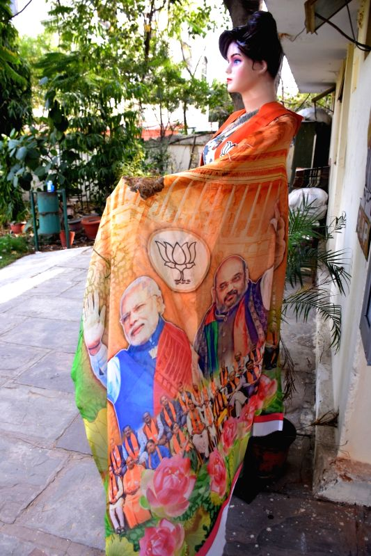 Jaipur: A saree with faces of Prime Minister Narendra Modi and BJP leader Amit Shah on display outside a shop in Jaipur, on March 9, 2019. (Photo: Ravi Shankar Vyas/IANS)