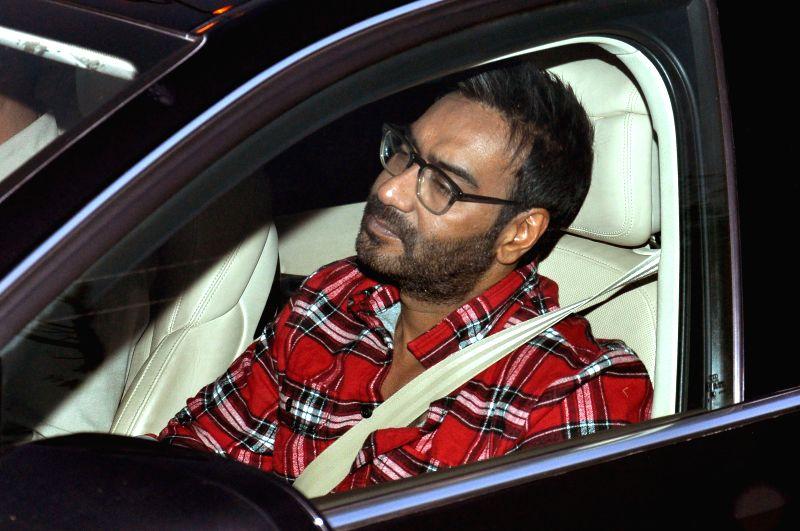 Actor Ajay Devgn arrives in Jaipur on Dec 23, 2014.