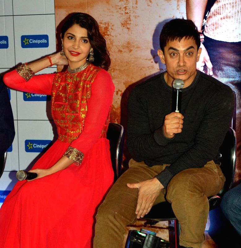 Actors Aamir Khan and Anushka Sharma during a press conference to promote their upcoming movie `PK` in Jaipur on Dec. 13, 2014.
