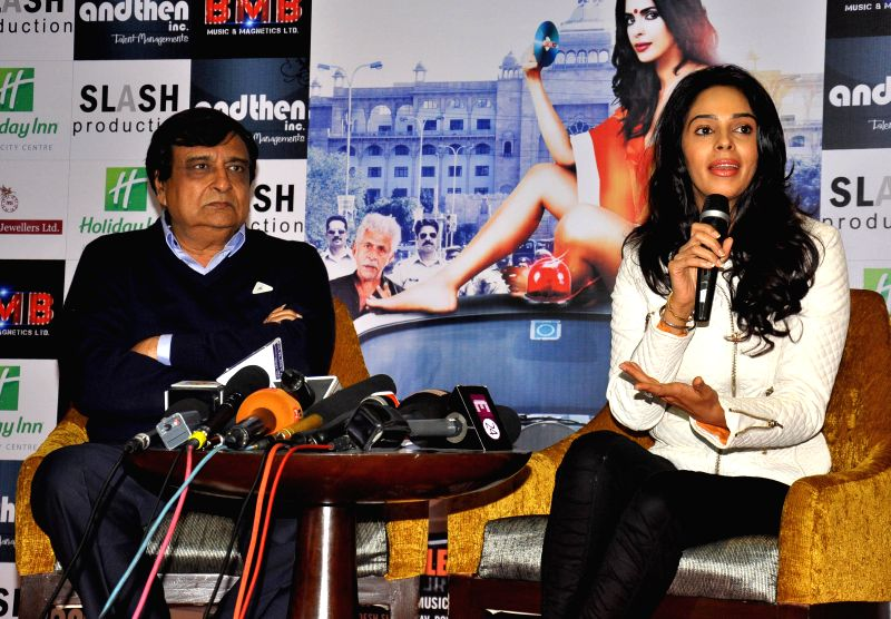 Actress Mallika Sherawat and filmmaker K. C. Bokadia during a press conference to promote their upcoming film `Dirty Politics` in Jaipur, on Jan 13, 2015. - Mallika Sherawat