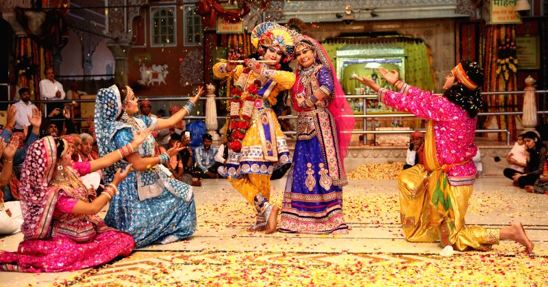 Artists disguised as lord Krishna and Radha perform during Phag Mahotsava at the Govind Devji temple in Jaipur, on March 1, 2015.