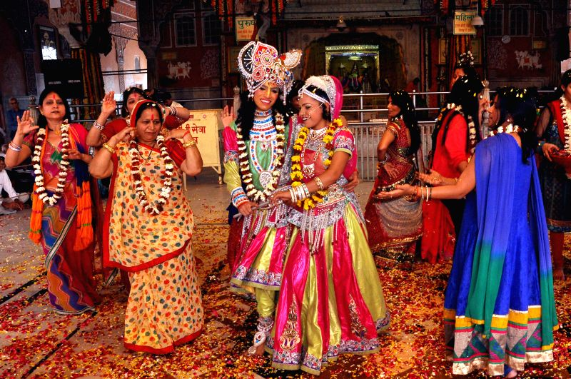 Artists dressed as lord Krishna and Radha celebrate Holi at Govind Devji Temple in Jaipur, on Feb 24, 2015.