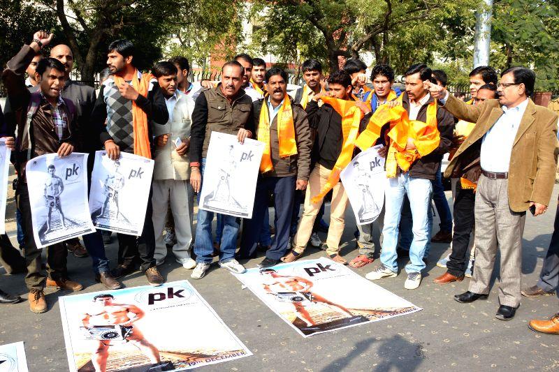 Bajrang Dal workers stage a protest against Aamir Khan starrer  `PK`, in Jaipur on Dec 30, 2014. - Aamir Khan
