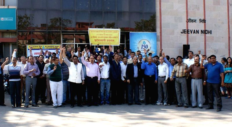 Bank employees stage a demonstration in front of a bank during a day-long strike called to press for their various demands including pay revision in Jaipur on Dec 3, 2014.