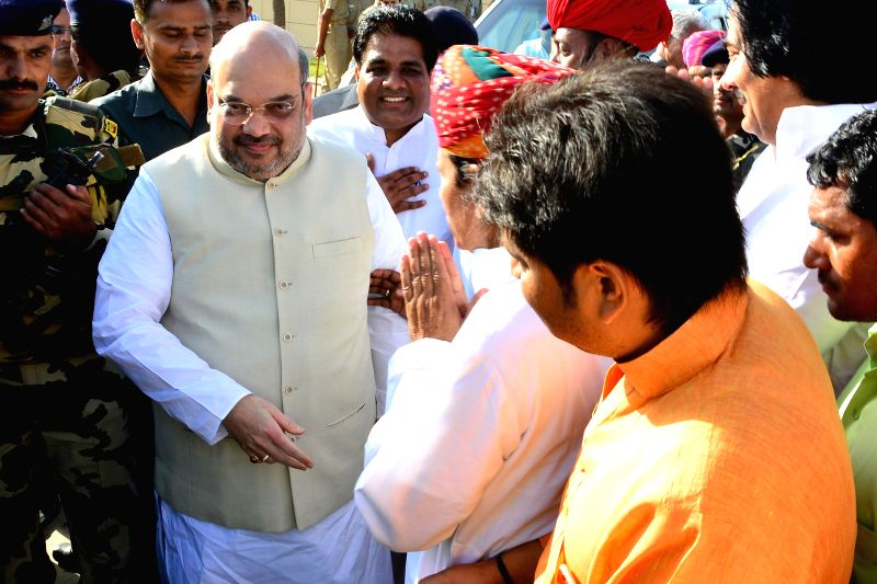 BJP chief Amit Shah being welcomed by party leaders at Sanganer airport near Jaipur on April 25, 2015.