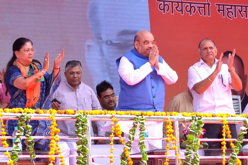 BJP chief Amit Shah, Rajasthan Chief Minister Vasundhara Raje and the state party chief Ashok Parnami during a party rally in Jaipur, on April 25, 2015. - Vasundhara Raje and Amit Shah