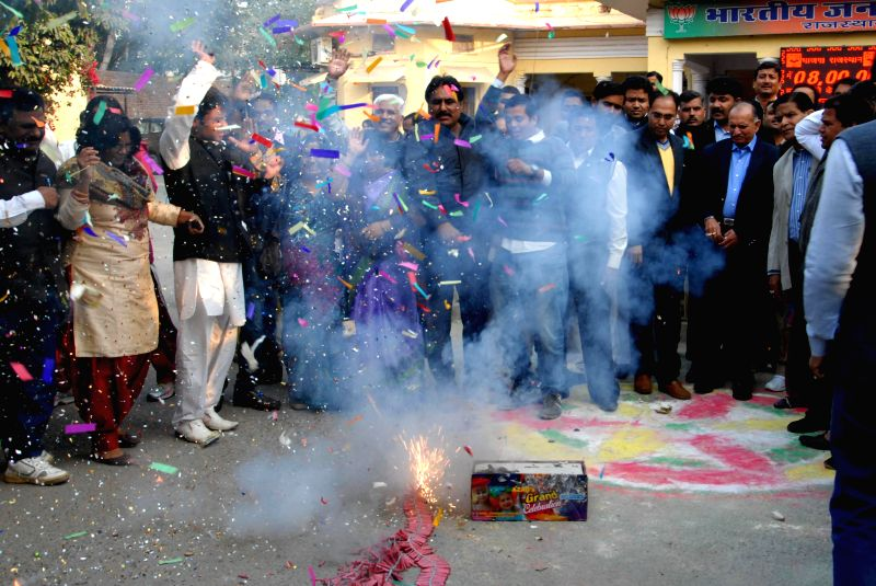 BJP workers celebrate party's performance in Jharkhand and Jammu and Kashmir assembly polls in Jaipur on Dec 23, 2014.