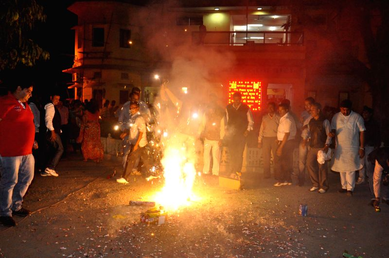 BJP workers celebrate party's win in the recent Municipal Corporation elections in Jaipur, on Nov 25, 2014.