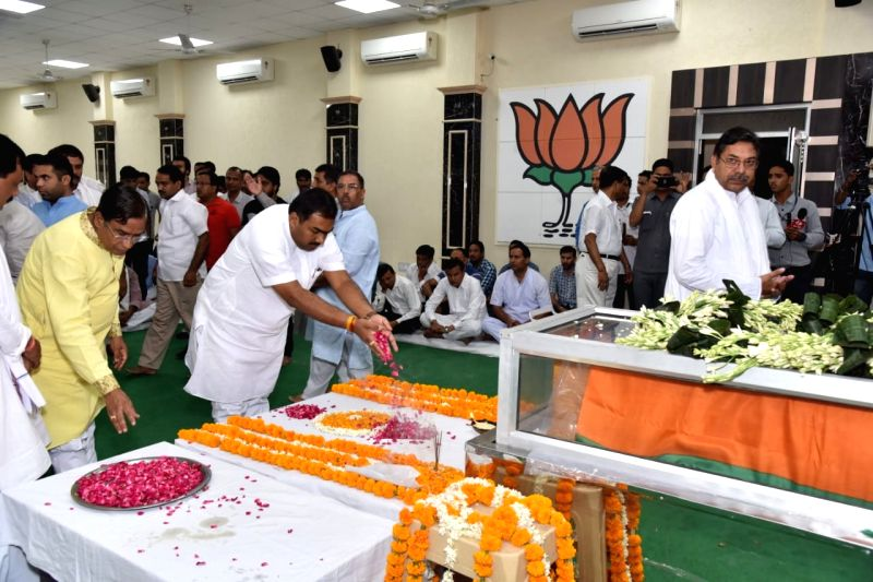 Jaipur: BJP workers pays tributes to state BJP chief Madan Lal Saini at the party state headquarters, in Jaipur on June 25, 2019. Saini, who was admitted at the All India Institute of Medical Sciences in New Delhi last week after a lung infection, di