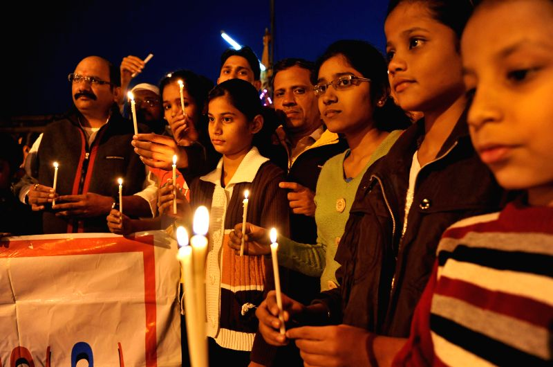 Children participate in a candle light vigil to protest against Tuesday's attack on the Army Public School in Peshawar, Pakistan, that claimed 104 lives mostly those of children, in Jaipur, ..