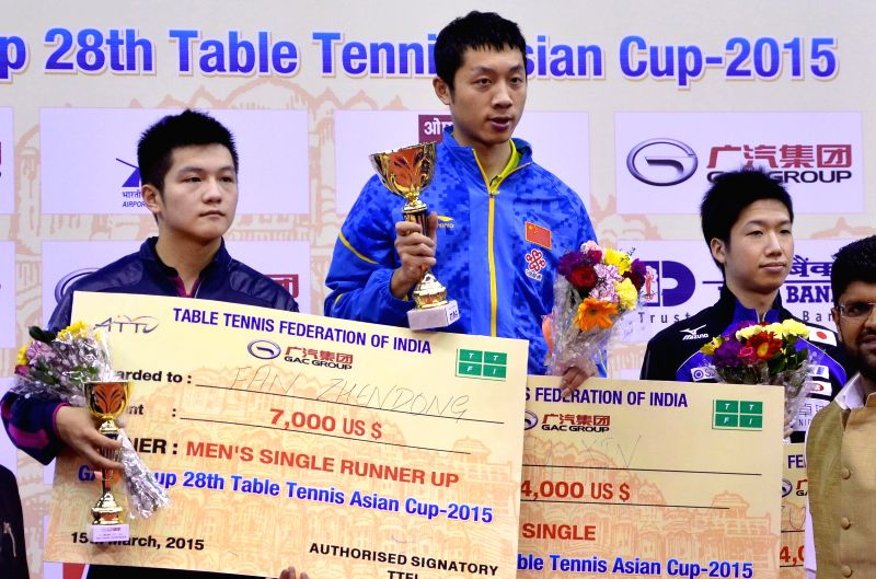 Chinese table tennis player Xu Xin during an award ceremony after winning the 28th Table Tennis Asian Cup (Men's) at Sawai Mansingh Indoor Stadium in Jaipur, on March 15, 2015.