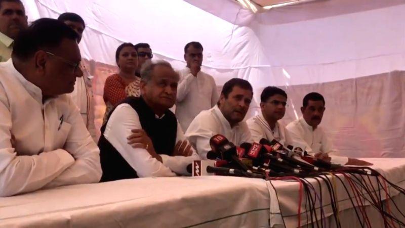 Jaipur: Congress President Rahul Gandhi talks to press after meeting Alwar gang-rape victim in Jaipur on May 16, 2019. Also seen Rajasthan Chief Minister Ashok Gehlot and Deputy Chief Minister Sachin Pilot.