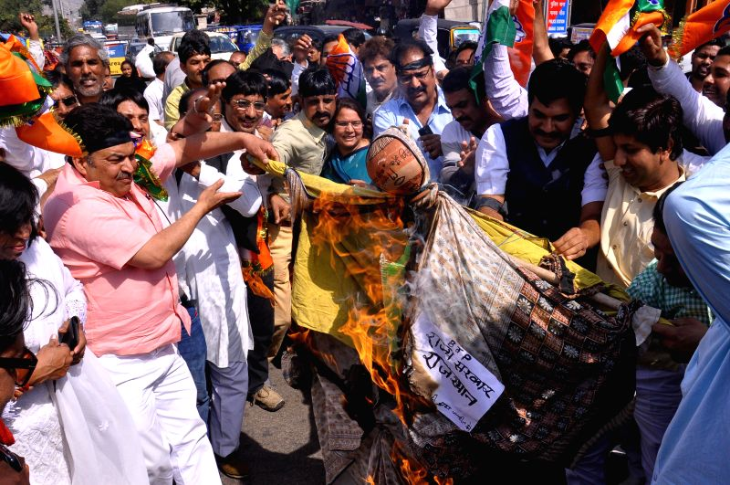 Congress workers stage a demonstration against failure of Rajasthan Government in dealing with swine flu, in Jaipur on Feb 19, 2015.