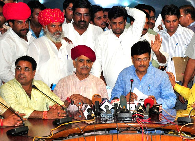 Jaipur: Gujjar leader Kirori Singh Bainsla addresses a press conference after a meeting with Rajasthan ministers in Jaipur, on May 28, 2015. (Photo: Ravi Shankar Vyas/IANS)