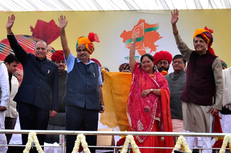 Minister of Road Transport and Highways Nitin Gadkari, Minister of Power Piyush Goyal, Rajasthan Chief Minister Vasundhara Raje Scindia, Rajasthan BJP Chief Ashok Parnami waves at crowd ... - Vasundhara Raje Scindia