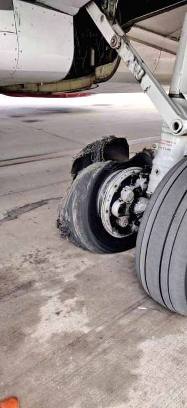 Jaipur: One of the tires of a SpiceJet aircraft that burst while taking off from Dubai, after making a safe landing at the Jaipur airport on June 12, 2019. Timely co-ordination by pilots and the air traffic control (ATC) helped the aircraft make a sa