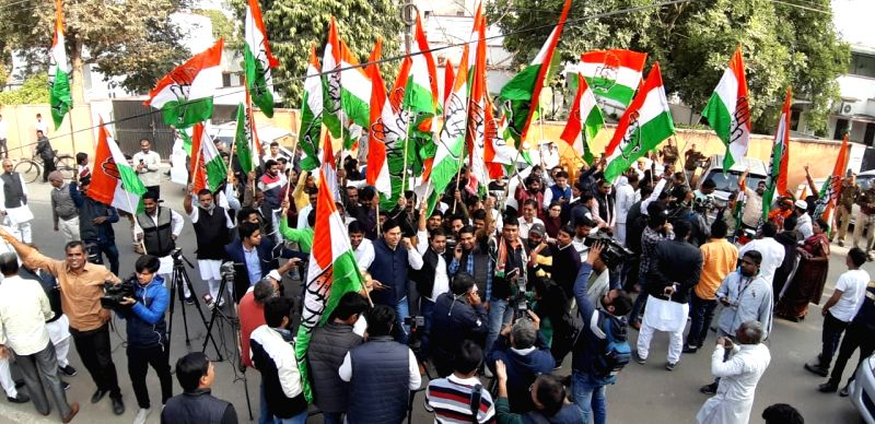 Jaipur: Party workers celebrate at Congress party office as Congress leads in the Rajasthan assembly elections in Jaipur on Dec 11, 2018.