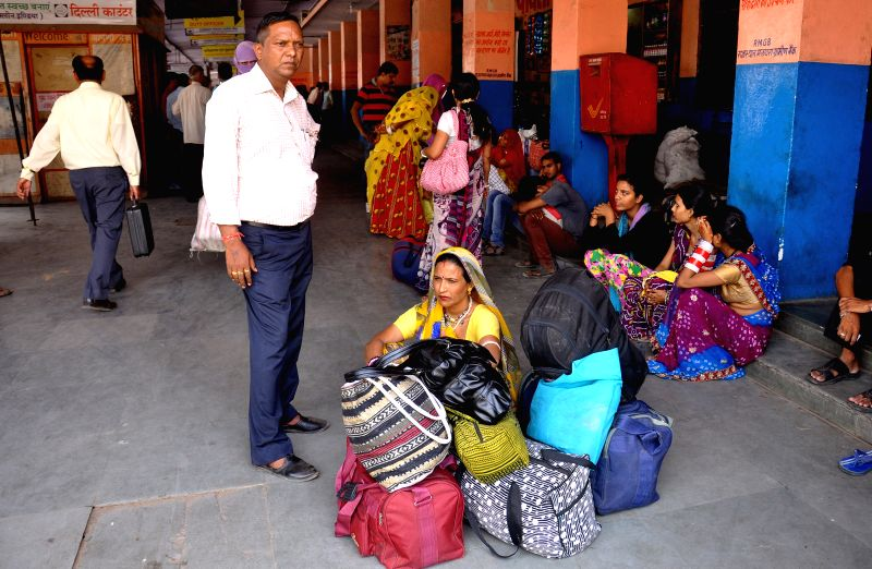 Passengers with their luggage waiting for transport outside at Sindhi Camp Bus terminal due to transport operators go on nation wide strike in Jaipur on April 30, 2015.