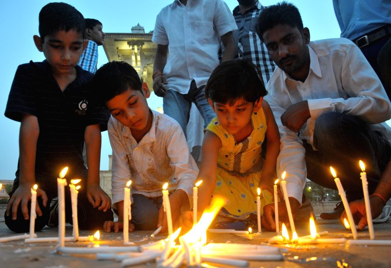 People pay tribute to the Nepal earthquake victims in Jaipur, on April 27, 2015.