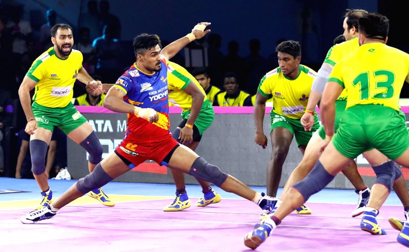 Jaipur: Players in action during Pro Kabaddi Season 7 match between U.P. Yoddha and Tamil Thalaivas at Sawai Mansingh Indoor Stadium in Jaipur on Sep 21, 2019.