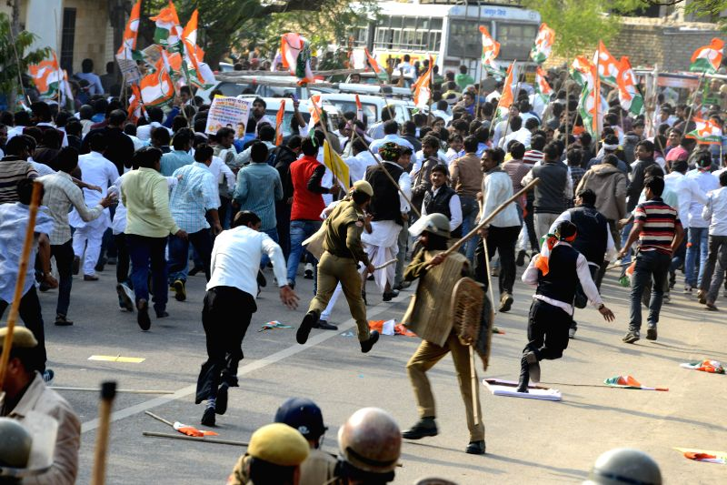 Police charge baton on Youth Congress activists demonstrating against the land acquisition ordinance near Rajasthan Legislative Assembly in Jaipur on March 3, 2015.