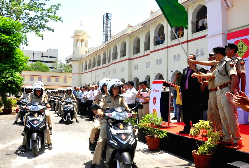 "Jaipur Police Commissioner Sanjay Agarwal flags off ""Lady Patrolling Unit"" an initiative aimed to help women in distress, in Jaipur on April 1, 2017. The all women unit is equipped ..."