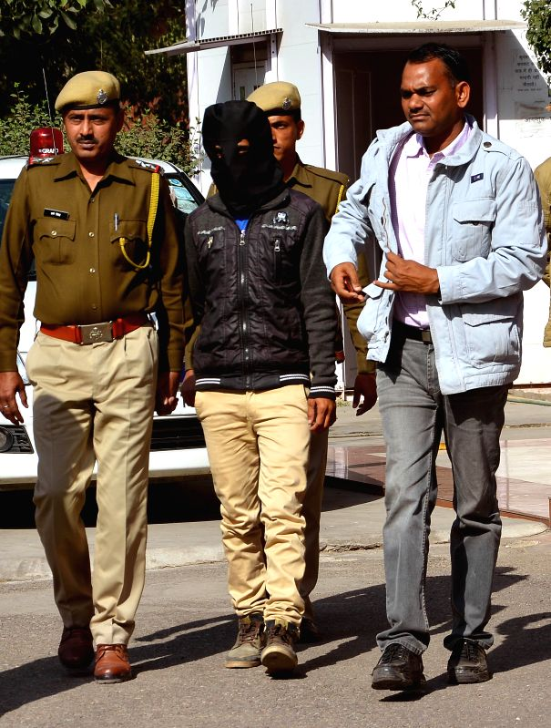 Police present before press a man accused of raping a Japanese tourist after he surrendered before them in Jaipur, on Feb 13, 2015.