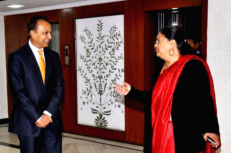 Rajasthan Chief Minister Vasundhara Raje with Reliance ADAG chairman Anil Ambani during a programme organised at the Chief Minister's Office in Jaipur, on Feb 12, 2015. - Vasundhara Raje