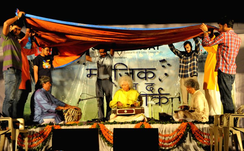 Santoor player and Padma Vibhushan Pandit Shivkumar Sharma performs during the `Music in The Park` organised by the Department of Tourism in Jaipur on April 11, 2015.