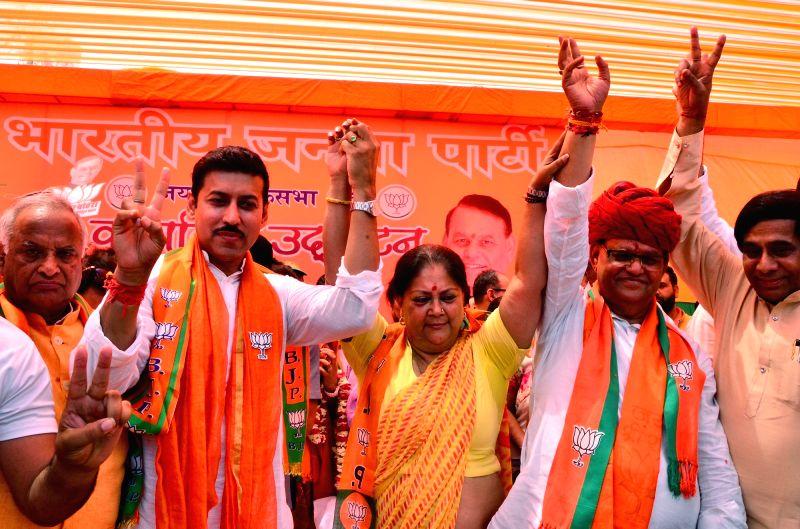Jaipur: Union Minister and BJP's Lok Sabha candidate from Jaipur rural, Rajyavardhan Singh Rathore, BJP leader Vasundhara Raje and BJP's Lok Sabha candidate from Jaipur, Ramcharan Bohara during an election campaign for the forthcoming Lok Sabha elect