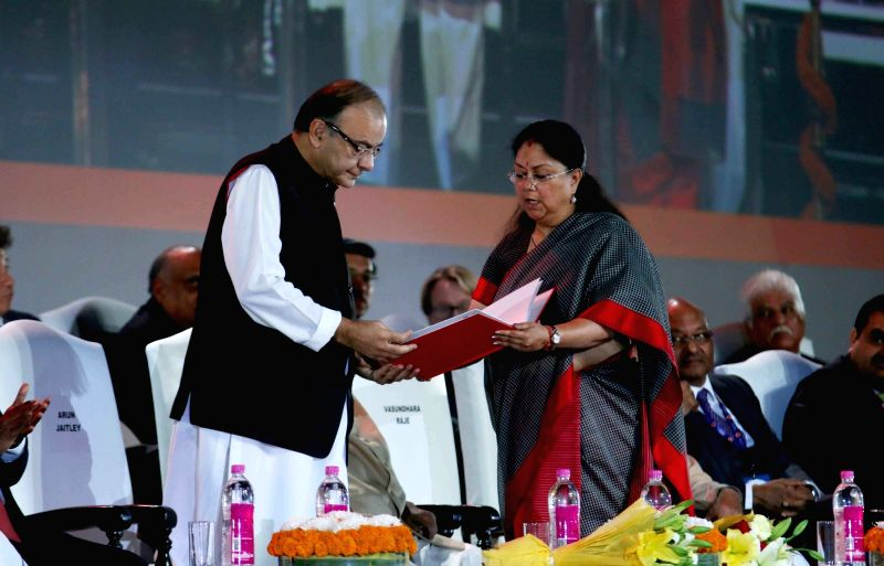 :Jaipur: Union Minister for Finance, Corporate Affairs, and Information and Broadcasting Arun Jaitley being welcomed by Rajasthan Chief Minister Vasundhara Raje at Resurgent Rajasthan Partnership ... - Arun Jaitley