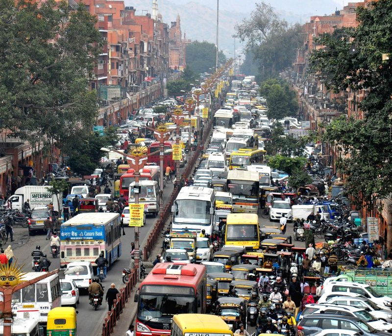 Vehicles stuck in a traffic jam at Johri Bazar Wall city in Jaipur on Jan. 3, 2014.