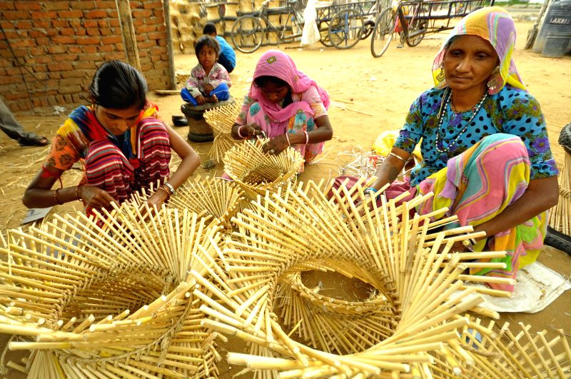 Women busy weaving cane furniture in Jaipur, on March 8, 2015. International Women's Day is being celebrated across the world.