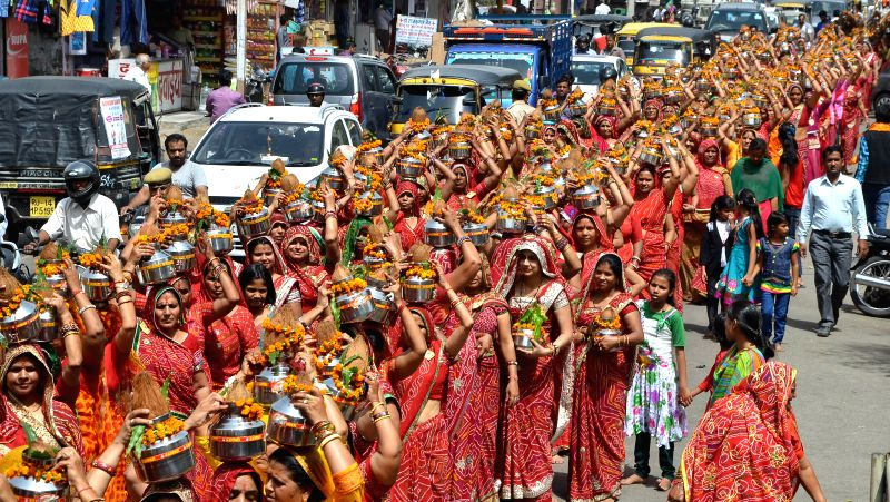 Women participate in Kalash Sobha Yatra on the eve of Hanuman Jayanti in Jaipur, on April 3, 2015.