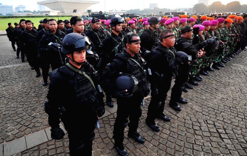 Indonesian National Army personnel line up during a security preparation for the 60th Asian-African Conference in Jakarta, Indonesia, April 15, 2015. Indonesia was ...