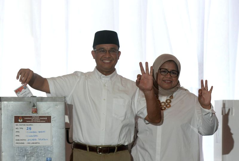 JAKARTA, April 19, 2017 - Jakarta's gubernatorial candidate Anies Baswedan (L) casts his ballot at a polling station during the gubernatorial election in Jakarta, Indonesia, April 19, 2017. Millions ... - Anies Baswedan