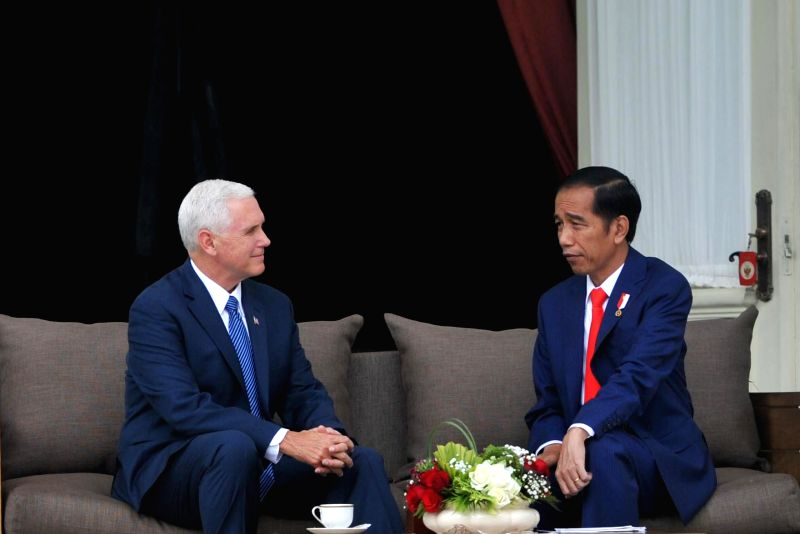 JAKARTA, April 20, 2017 - Indonesian President Joko Widodo (R) talks with U.S. Vice President Mike Pence at the Merdeka Palace in Jakarta, Indonesia, April 20, 2017.