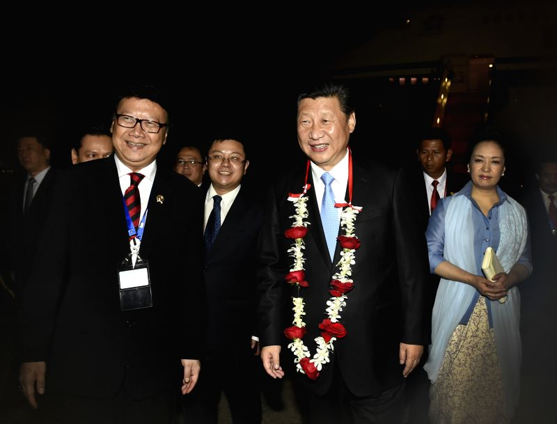 Chinese President Xi Jinping and his wife Peng Liyuan are welcomed upon their arrival in Jakarta, capital of Indonesia, April 21, 2015. Xi Jinping arrived in ...