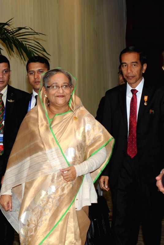 Indonesian president Joko Widodo (1st R) walks with Bangladeshi Prime Minister Sheikh Hasina (2nd R) after a bilateral meeting on the sidelines of Asia-African ... - Sheikh Hasina