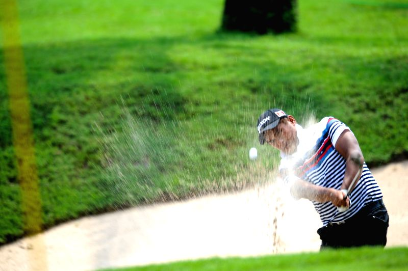 Chaphai Nirat of Thailand hits the ball from bunker in the hole 9 during day 3 of CIMB Niaga Indonesian Masters at Royale Jakarta Golf Club, Jakarta, Indonesia, ...