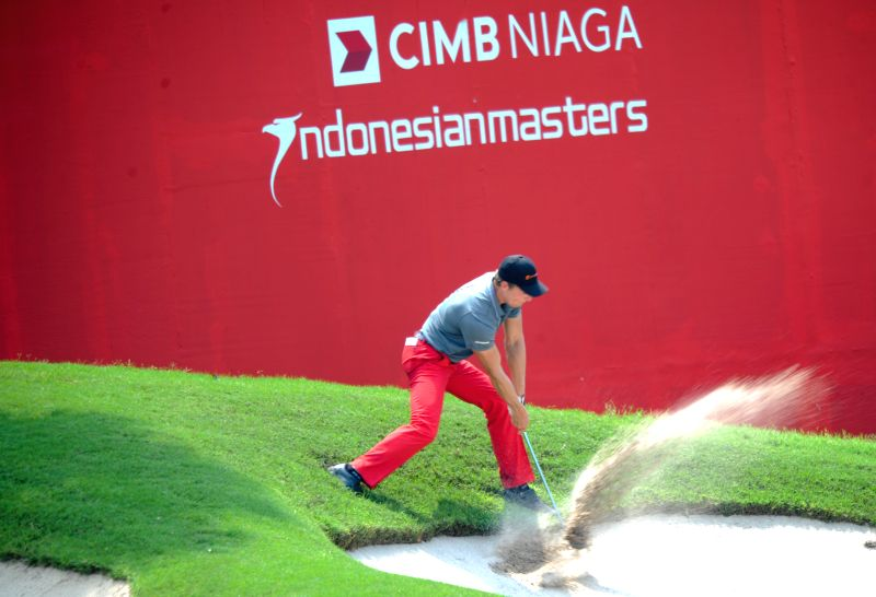 Elias Bertheussen of Norway hits the ball in the hole 9 during day 3 of CIMB Niaga Indonesian Masters at Royale Jakarta Golf Club, Jakarta, Indonesia, April 26, ...