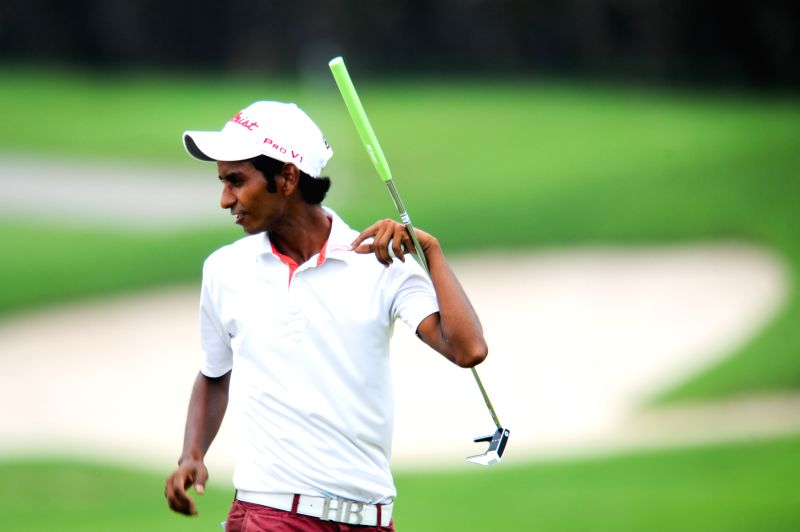 Rashid Khan of India expresses his happiness after successfully put the ball into the hole during day 3 of CIMB Niaga Indonesian Masters at Royale Jakarta Golf ... - Rashid Khan