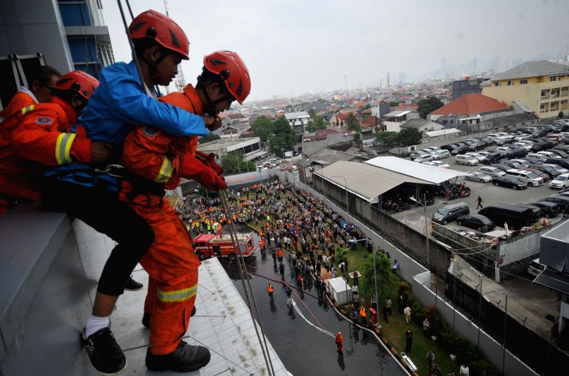 JAKARTA, April 26, 2017 - Rescue members participate in a drill held by Indonesia's National Disaster Management Authority (BNPB) during National Disaster Preparedness Day in Jakarta, Indonesia. ...