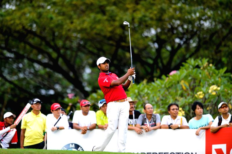 Anirban Lahiri of India hits the ball during the final day of CIMB Niaga Indonesian Masters at Royale Jakarta Golf Club in Jakarta, Indonesia, April 27, 2014. ...